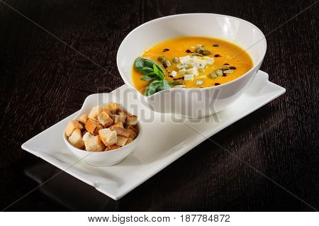 Pumpkin and soup with cream and pumpkin seeds