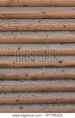 The wall of a wooden house from calibrated logs