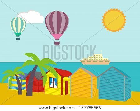 A row of beach huts against blue sky and sand and sea.