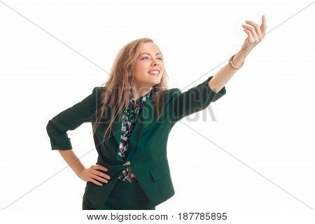 pretty funny young blonde in green jacket lends a helping hand up smiling on the isolated on white background.
