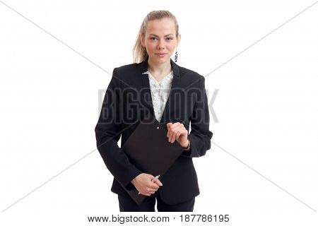 beautiful young blonde business stands in the black suit holding a paper and smiling isolated on white background