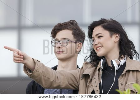 Two Smiling Young Teenage Boy And Girl Planning To Look Around And Visit The City