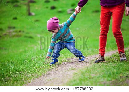 The Boy Walks With His Mother Through The Meadow.