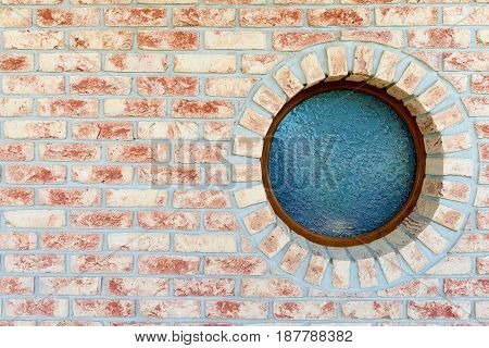 Round window on brick wall - with copy space