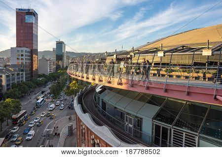 BARCELONA SPAIN - OCTOBER 23 2015: People looking at sunset from the roof of Las Arenas - shopping mall in Barcelona Spain