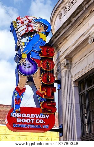 Nashville, TN, USA - 04/05/2015: Broadway Boot Company overhead neon sign in downtown Nashville Tennessee