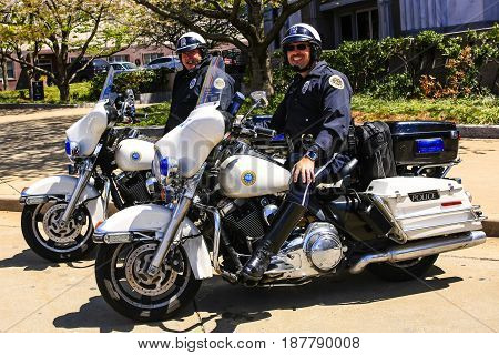 Nashville, TN, USA - 04/05/2015: Nashville motorcycle cops looking for traffic violation offenders on the busy downtown Broadway street