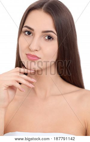 Beauty Spa Woman with perfect skin Portrait. Beautiful Brunette Spa Girl showing empty copy space on the open hand palm for text. Proposing a product. Gestures for advertisement. Isolated  background