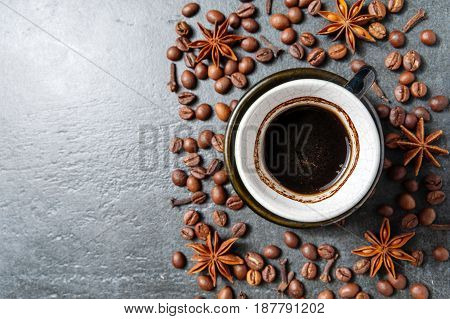 Coffee Cup With Coffee Beans On Stone Table Background With Star Anise.