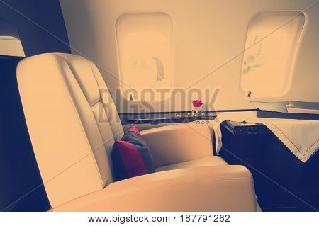 corporare private Jet Interior with leather chair instagram tone