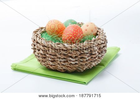Easter colored chicken eggs which a rabbit brought in a wooden basket