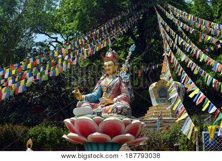 Statue and prayer flags in Swayambhu Swayambhunath Temple in Kathmandu, Nepal.