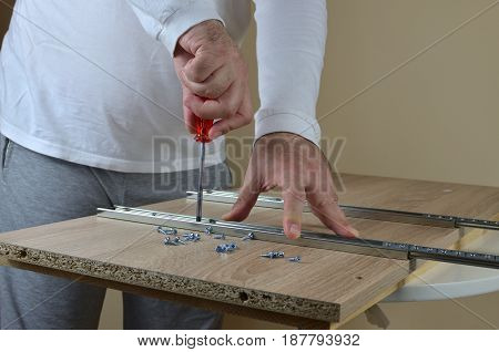 Man Installing A Drower