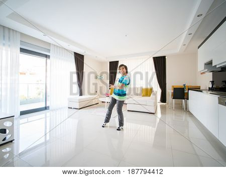 Happy boy at living room apartment
