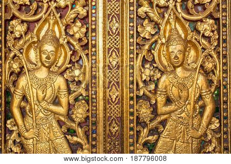 Beautiful golden carving on the door of Wat Sensoukharam temple in Luang Prabang, Laos