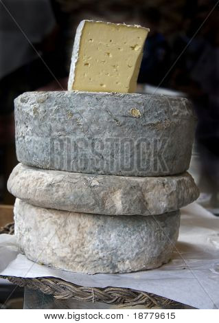 A still life of French cheeses at a market, Rennes, Brittany