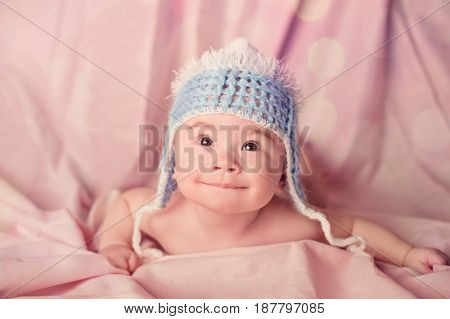 Cute baby portrait dressed in blue knitted hat