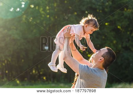 Happy Young Mixed Race Ethnic Family Walking Outdoors.