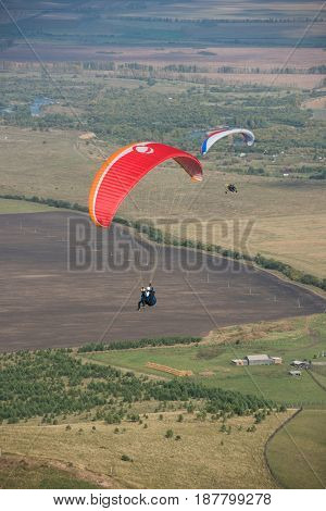 Paragliding in mountains. Para gliders in fight in the mountains, extreme sport activity.