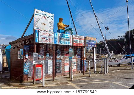 Newquay, Cornwall, Uk - April 1 2017: Kiosks Selling Fishing Trips And Boat Rides On The Harbour Fro
