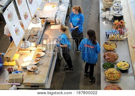 Bodelva Cornwall UK - April 4 2017: Kitchen staff preparing oriental food for guests at the Eden Project in Cornwall England