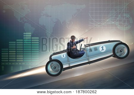 Businessman riding sports car against charts