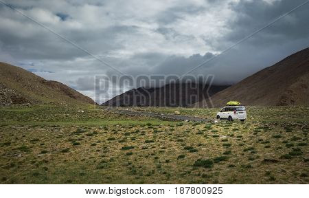 Expedition vehicle on mountain road Indian Himalaya