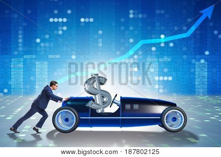 Businessman pushing car with dollar in driving seat