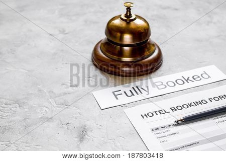 booking hotel room application form and ring on stone desk background