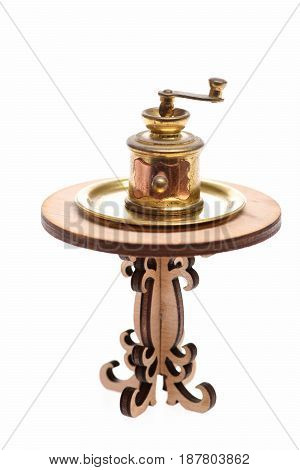 Antique Brass Coffee Grinder On Golden Tray Isolated On White