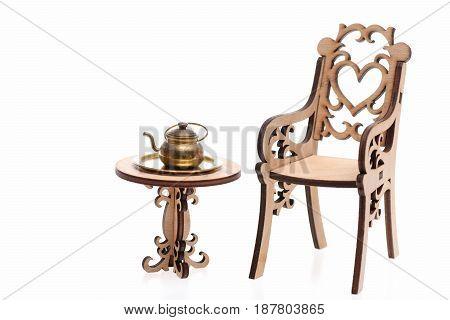 Antique Teapot On Decorative Wooden Table