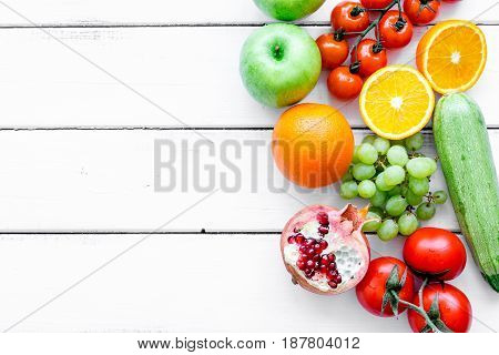 Organic fruits and vegetables for healthy dinner on white background top view mock up