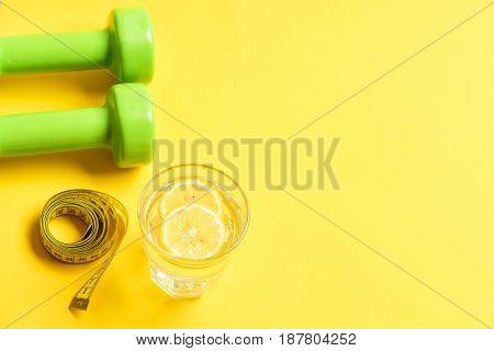 Against Excess Weight Concept With Dumbbells, Measuring Tape, Lemon Water