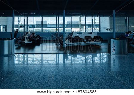 FRANKFURT GERMANY - JUL 3 2015: Interior of Frankfurt airport with people waiting for their airline delayed flight or plane arrival departure
