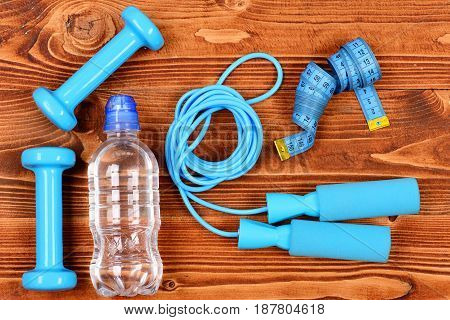 Sport Objects Concept, Bottle, Skipping Rope, Measuring Tape And Dumbbells
