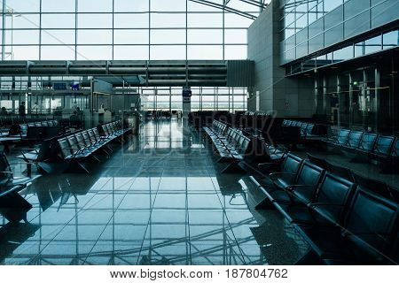 FRANKFURT GERMANY - JUL 3 2015: Empty seats in Frankfurt International airport in blue tones - no passengers and clients for first class flights