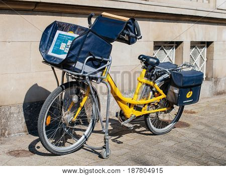 STRASBOURG FRANCE - APR 8 2017: Yellow La Poste postal bicycle in French city - postman went to deliver the mail