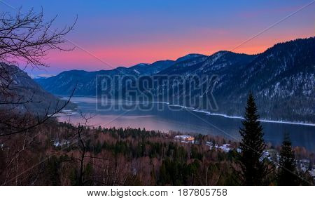 Teletskoye Lake And Altai Mountains In Pink And Purple Colors Of Sunset