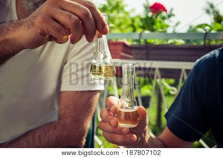 Cheers! Hand Toasting With Glasses Of Brandy