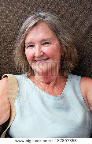 Mature female blond senior beauty expressions outside.