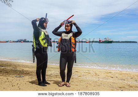 Labuan,Malaysia-Feb 19,2017:Young woman with life jacket & snorkel gear,ready to having fun doing snorkel watersport activity in Papan island of Labuan,Malaysia.