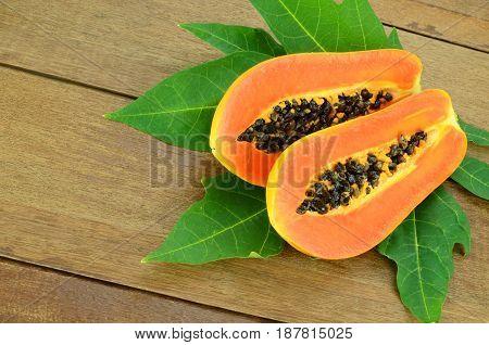 Ripe Papaya On Wood Background.