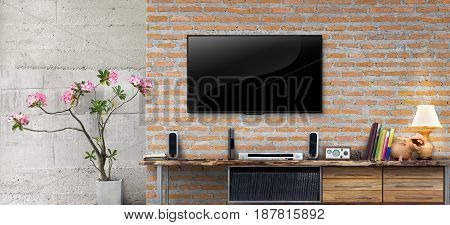 Tv on red brick wall with wooden table in living room interior