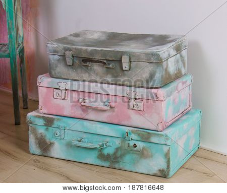 beautiful old blue, pink and gray suitcases or bags - retro style.