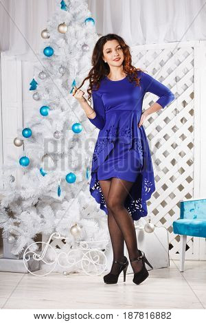 beautiful brunette in a dark blue background on Christmas