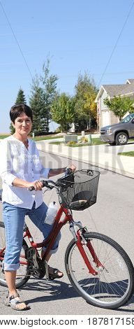 Mature female beauty on her bike outdoors.