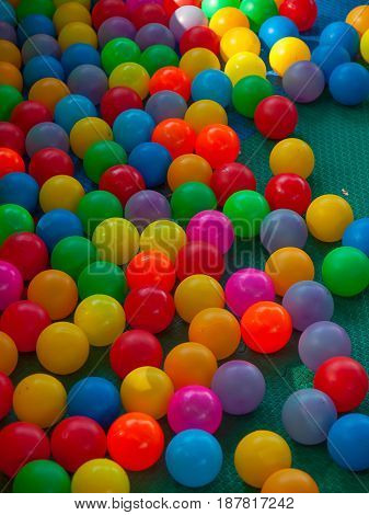 Colored balls and Colorful beauty is the background.