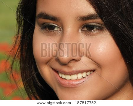 A Smiling Face Of Hispanic Girl Teenager