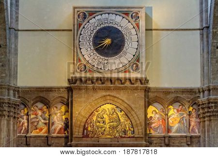 The one-handed liturgical clock with fresco portraits of four Prophets above the main door of the Cathedral (Duomo) - Florence Tuscany Italy, 11 October 2011