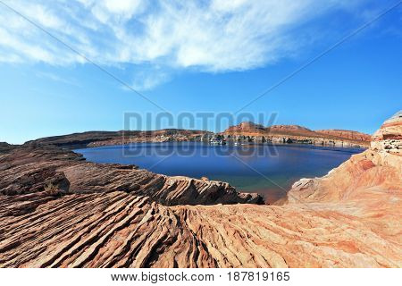 Magnificent Lake Powell. The small bay in the middle of the desert rock of red-orange striped sandstone. Photo taken fisheye lens
